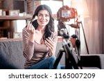 great makeup artist. cheerful... | Shutterstock . vector #1165007209