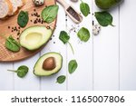avocado and baby spinach  bread ... | Shutterstock . vector #1165007806