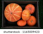 Small Orange Pumpkins Stacked...