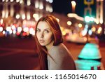 redheaded girl on the... | Shutterstock . vector #1165014670
