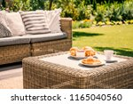 beige color wicker table and... | Shutterstock . vector #1165040560
