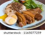 taiwanese slow cooked pork... | Shutterstock . vector #1165077259