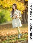 fashionable little girl autumn  | Shutterstock . vector #1165087063