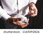 man holding bottle of perfume... | Shutterstock . vector #1165092826