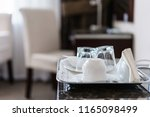 empty glasses and phone in... | Shutterstock . vector #1165098499