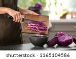 woman cooking fresh salad with... | Shutterstock . vector #1165104586