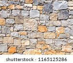 fragment of a wall from a... | Shutterstock . vector #1165125286