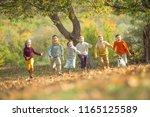 happy autumn children   | Shutterstock . vector #1165125589