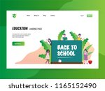 happy kids with chalkboard.... | Shutterstock .eps vector #1165152490