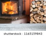 old wooden table and fireplace... | Shutterstock . vector #1165159843