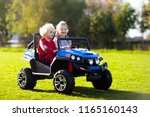 kids driving electric toy car...   Shutterstock . vector #1165160143