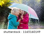 kids with colorful umbrella... | Shutterstock . vector #1165160149