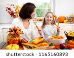 mother and daughter cutting... | Shutterstock . vector #1165160893