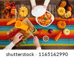 mother and daughter cutting...   Shutterstock . vector #1165162990