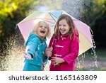 kids with colorful umbrella... | Shutterstock . vector #1165163809