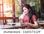 beauty asian woman sitting... | Shutterstock . vector #1165171129