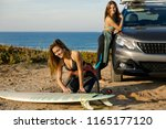 two beautiful surfer girls near ... | Shutterstock . vector #1165177120
