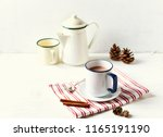 mug of hot milk with cocoa and... | Shutterstock . vector #1165191190