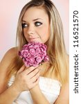 Bride holding a bouquet of pink chrysanthemums - stock photo