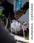 barkeeper pouring gin | Shutterstock . vector #1165216666