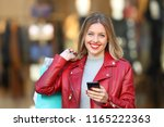happy shopper posing holding a... | Shutterstock . vector #1165222363