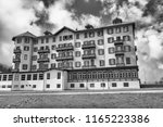alpine resort on a cloudy... | Shutterstock . vector #1165223386