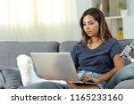 serious desabled woman using a...   Shutterstock . vector #1165233160