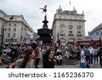 people enjoying the sun at... | Shutterstock . vector #1165236370