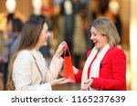 side view of an smiley shopper... | Shutterstock . vector #1165237639