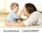 affectionate mother and baby... | Shutterstock . vector #1165243099