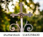 old rusty catholic cross on the ... | Shutterstock . vector #1165258630