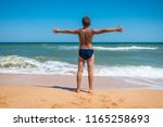 adorable boy standing on the... | Shutterstock . vector #1165258693