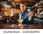 male bartender prepares... | Shutterstock . vector #1165266943