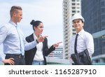 friend pointing to the engineer ... | Shutterstock . vector #1165287910