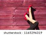 closeup of woman's legs wearing ...   Shutterstock . vector #1165296319