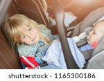 brother and sister sitting in... | Shutterstock . vector #1165300186