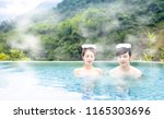 young asian couple relaxing in... | Shutterstock . vector #1165303696