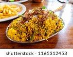 vegetable biryani. vegetarian... | Shutterstock . vector #1165312453