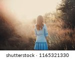 back view of a beautiful young... | Shutterstock . vector #1165321330