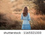 back view of a beautiful young... | Shutterstock . vector #1165321333