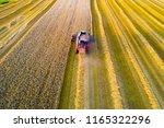 combine harvester at work.... | Shutterstock . vector #1165322296