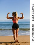 back view of strong fitness...   Shutterstock . vector #1165322983