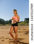 fit shredded woman showing her...   Shutterstock . vector #1165322989