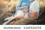 close up of human hands holding ... | Shutterstock . vector #1165326253