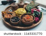 scrambled tofu served with... | Shutterstock . vector #1165331770