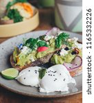 smashed avocado on toast with...   Shutterstock . vector #1165332226
