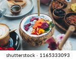healthy blue smoothie bowl... | Shutterstock . vector #1165333093