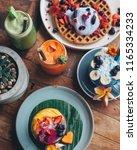 healthy blue smoothie drink... | Shutterstock . vector #1165334233