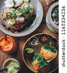 burrito served with sauces for... | Shutterstock . vector #1165334236