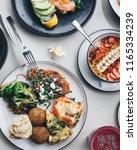 mediterranean food platter with ... | Shutterstock . vector #1165334239